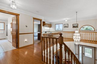Photo 19: 927 Shawnee Drive SW in Calgary: Shawnee Slopes Detached for sale : MLS®# A1123376
