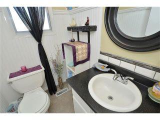 Photo 21: 10 GLENPATRICK Crescent: Cochrane House for sale : MLS®# C4094257