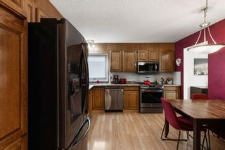 Photo 9: 7 Woodmont Rise SW in Calgary: Woodbine Detached for sale : MLS®# A1092046