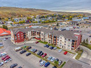 Photo 1: 1207 505 RAILWAY Street W: Cochrane Apartment for sale : MLS®# A1149928