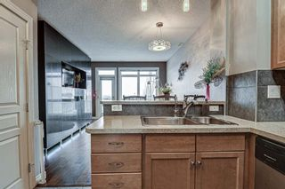 Photo 3: 7 124 Rockyledge View NW in Calgary: Rocky Ridge Row/Townhouse for sale : MLS®# A1111501