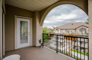 """Photo 22: 411 20281 53A Avenue in Langley: Langley City Condo for sale in """"Gibbons Layne"""" : MLS®# R2621680"""