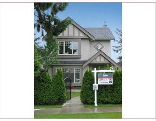 Photo 1: 718 W 68TH Avenue in Vancouver: Marpole 1/2 Duplex for sale (Vancouver West)  : MLS®# V651520
