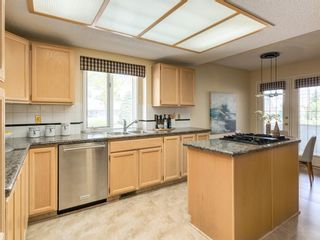 Photo 12: 25 PUMP HILL Landing SW in Calgary: Pump Hill Semi Detached for sale : MLS®# A1013787