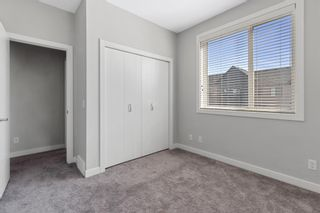 Photo 22: 903 Redstone Crescent NE in Calgary: Redstone Row/Townhouse for sale : MLS®# A1096519