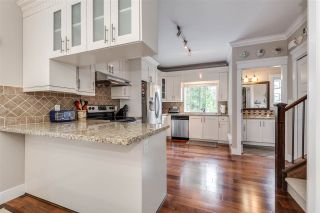 """Photo 7: 119 3333 DEWDNEY TRUNK Road in Port Moody: Port Moody Centre Townhouse for sale in """"CENTRE POINT"""" : MLS®# R2408387"""