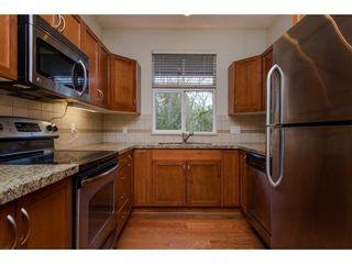 """Photo 9: 408 33328 E BOURQUIN Crescent in Abbotsford: Central Abbotsford Condo for sale in """"Nature's Gate"""" : MLS®# R2235279"""