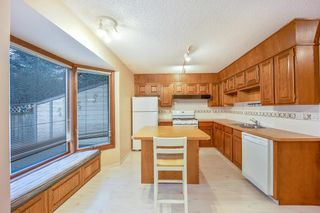 Photo 11: 7050 Edgemont Drive NW in Calgary: Edgemont Row/Townhouse for sale : MLS®# A1108400