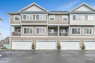Photo 1: 536 Cranford Drive SE in Calgary: Cranston Row/Townhouse for sale : MLS®# A1097565