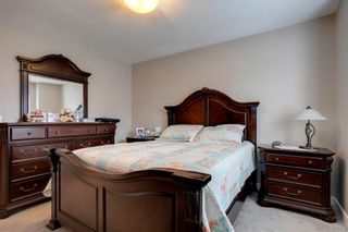 Photo 18: 15 West Coach Manor SW in Calgary: West Springs Row/Townhouse for sale : MLS®# A1100327