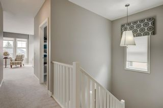 Photo 19: 707 Shawnee Drive SW in Calgary: Shawnee Slopes Detached for sale : MLS®# A1109379