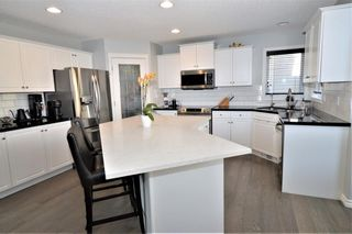Photo 3: 7476 Springbank Way SW in Calgary: Springbank Hill Detached for sale : MLS®# A1071854