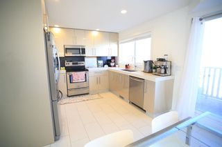 Photo 10: 104 1530 Bayside Avenue SW: Airdrie Row/Townhouse for sale : MLS®# A1147383