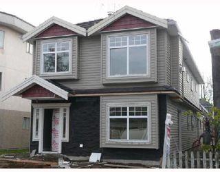 Photo 4: 450 E 44TH Avenue in Vancouver: Fraser VE 1/2 Duplex for sale (Vancouver East)  : MLS®# V681157