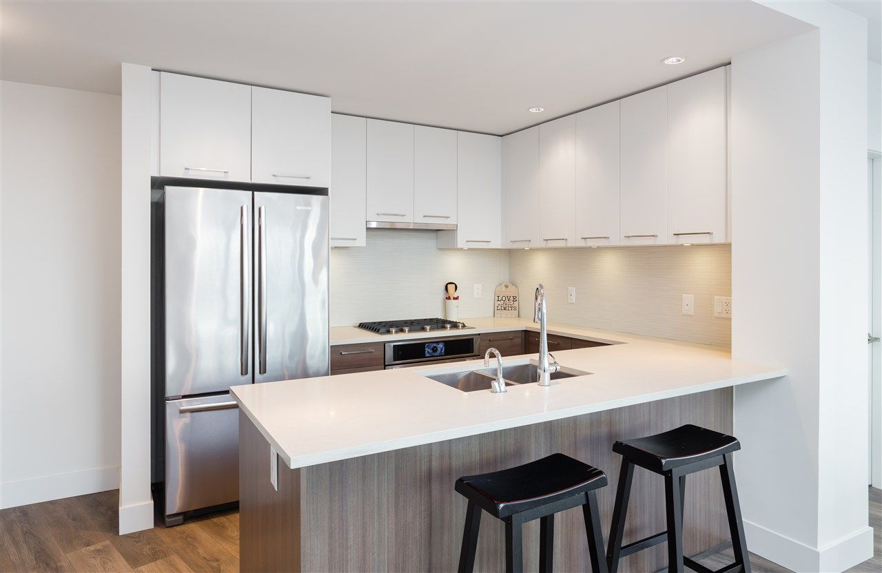 "Photo 4: Photos: 308 8580 RIVER DISTRICT CROSSING in Vancouver: Champlain Heights Condo for sale in ""TWO TOWN CENTER"" (Vancouver East)  : MLS®# R2354224"