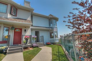 Main Photo: 97 Patina Point SW in Calgary: Patterson Row/Townhouse for sale : MLS®# A1131312