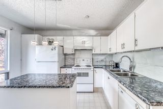 Photo 4: 26 5019 46 Avenue SW in Calgary: Glamorgan Row/Townhouse for sale : MLS®# A1147029