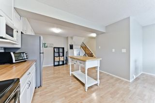 Photo 11: #37 10 Point Drive NW in Calgary: Point McKay Row/Townhouse for sale : MLS®# A1074626