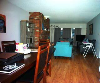 Photo 3: 7476 ROSEWOOD Street in Burnaby: Burnaby Lake Duplex for sale (Burnaby South)  : MLS®# R2514088