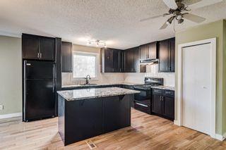 Photo 2: 20 Deerfield Circle SE in Calgary: Deer Ridge Detached for sale : MLS®# A1150049