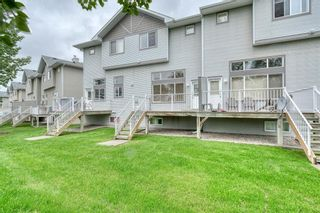 Photo 40: 66 Crystal Shores Cove: Okotoks Row/Townhouse for sale : MLS®# C4305435