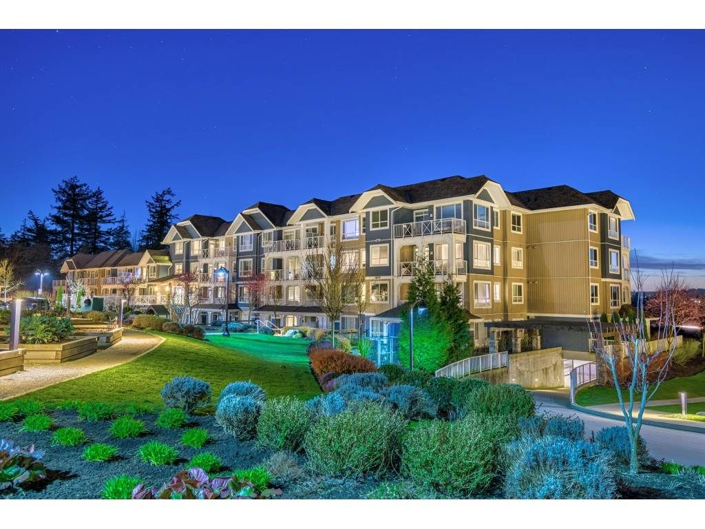 """Main Photo: 105 16380 64 Avenue in Surrey: Cloverdale BC Condo for sale in """"The Ridgse and Bose Farms"""" (Cloverdale)  : MLS®# R2556734"""