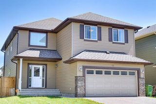 Photo 1: 61 Everhollow Green SW in Calgary: Evergreen Detached for sale : MLS®# A1115077