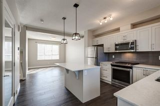 Photo 12: 103 Walgrove Cove SE in Calgary: Walden Row/Townhouse for sale : MLS®# A1145152