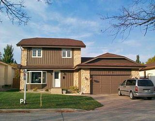 Photo 1: 35 HENNESSEY Drive in Winnipeg: River Heights / Tuxedo / Linden Woods Single Family Detached for sale (South Winnipeg)  : MLS®# 2617381