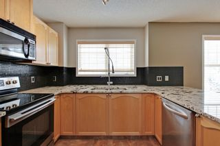 Photo 7: 3103 7171 Coach Hill Road SW in Quinterra: Townhouse for sale : MLS®# C3635341