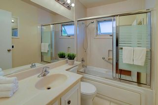 Photo 12: 50 FRASER Road SE in Calgary: Fairview Detached for sale : MLS®# A1145619