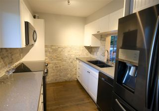 "Photo 1: 901 BRITTON Drive in Port Moody: North Shore Pt Moody Townhouse for sale in ""WOODSIDE VILLAGE"" : MLS®# R2290953"