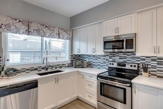 Photo 21: 919 Nolan Hill Boulevard NW in Calgary: Nolan Hill Row/Townhouse for sale : MLS®# A1141802
