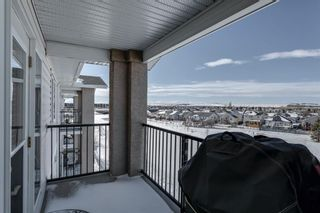Photo 28: 406 300 Edwards Way NW: Airdrie Apartment for sale : MLS®# A1071313