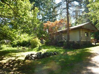 Photo 1: 729 Cramer Rd in : Isl Quadra Island House for sale (Islands)  : MLS®# 881631