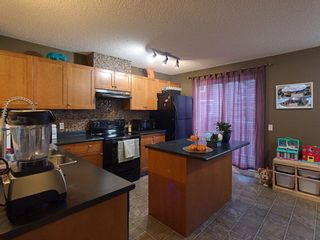 Photo 5: 117 Elgin Gardens SE in Calgary: McKenzie Towne Row/Townhouse for sale : MLS®# A1060562