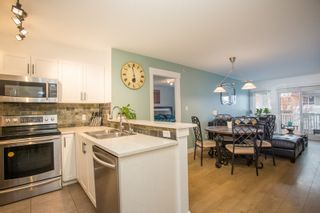"Photo 4: 404 20750 DUNCAN Way in Langley: Langley City Condo for sale in ""FAIRFIELD LANE"" : MLS®# R2564057"