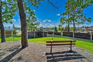 Photo 3: 218 Storybook Terrace NW in Calgary: Ranchlands Row/Townhouse for sale : MLS®# A1126980