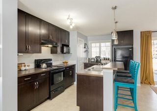 Photo 11: 69 PRESTWICK Villas SE in Calgary: McKenzie Towne Row/Townhouse for sale : MLS®# A1077678