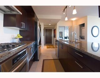 """Photo 8: 906 1650 W 7TH Avenue in Vancouver: Fairview VW Condo for sale in """"VIRTU"""" (Vancouver West)  : MLS®# V748830"""