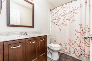 Photo 18: 85 Hidden Creek Rise NW in Calgary: Hidden Valley Row/Townhouse for sale : MLS®# A1104213