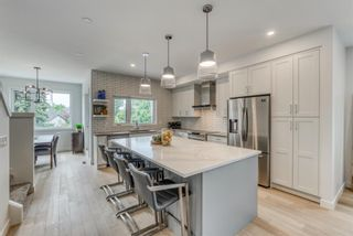 Photo 12: 98 23 Street NW in Calgary: West Hillhurst Row/Townhouse for sale : MLS®# A1066637