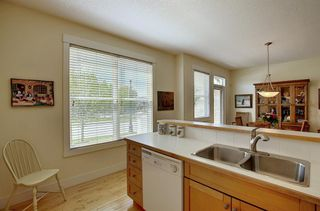 Photo 14: 45 Discovery Heights SW in Calgary: Discovery Ridge Row/Townhouse for sale : MLS®# A1109314