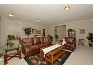 Photo 32: 134 GLENEAGLES View: Cochrane House for sale : MLS®# C4018773
