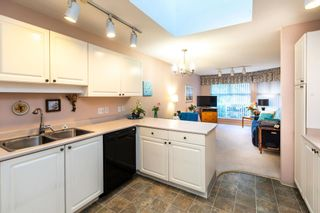 Photo 5: 107 16080 82 Avenue in Surrey: Fleetwood Tynehead Townhouse for sale : MLS®# R2602077