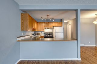 Photo 8: 57 Millview Green SW in Calgary: Millrise Row/Townhouse for sale : MLS®# A1135265
