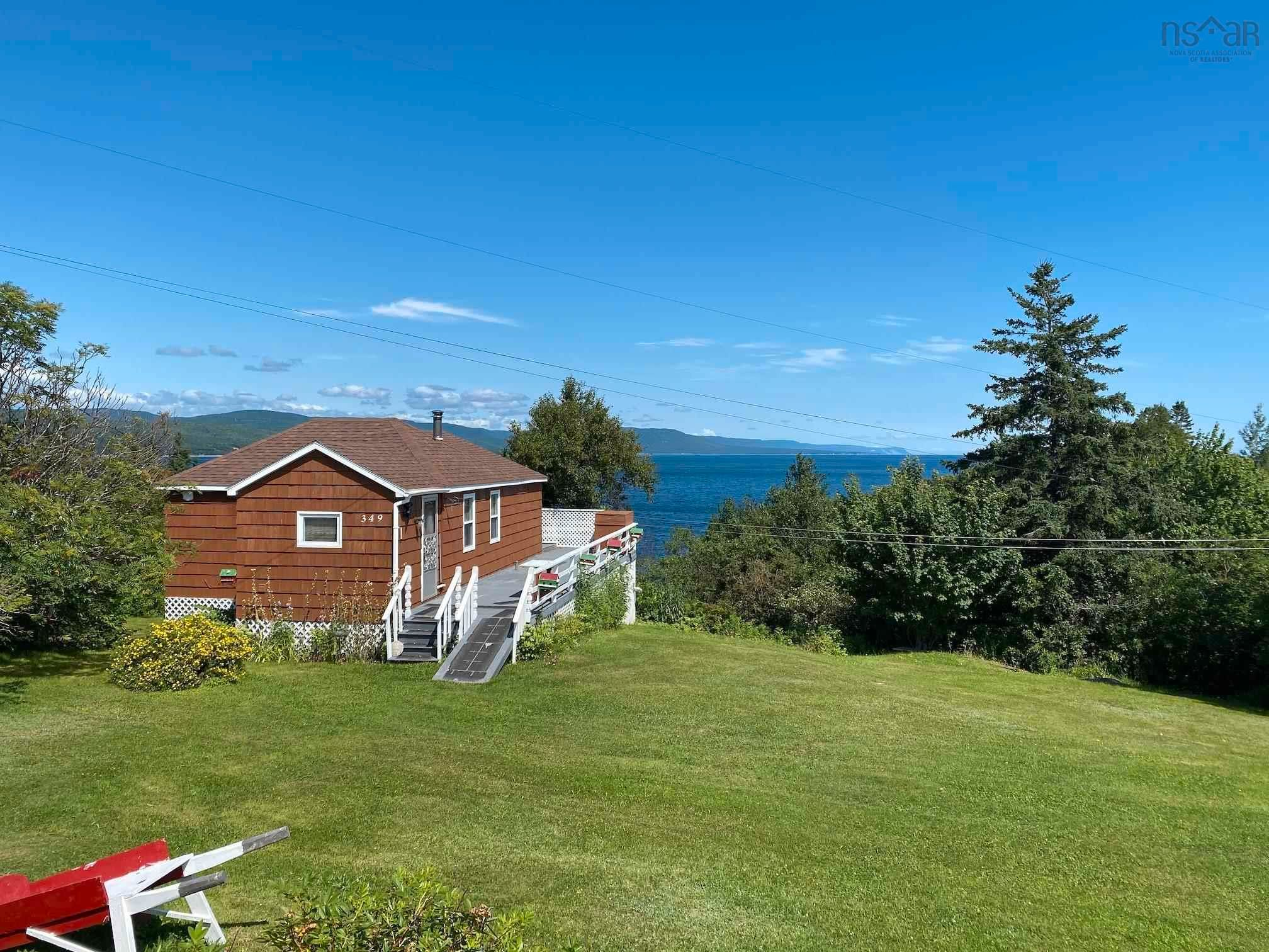 Main Photo: 349 Black Head Road in Englishtown: 209-Victoria County / Baddeck Residential for sale (Cape Breton)  : MLS®# 202121386