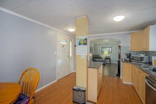 """Photo 5: 182 7790 KING GEORGE Boulevard in Surrey: East Newton Manufactured Home for sale in """"CRISPEN BAYS"""" : MLS®# R2591510"""
