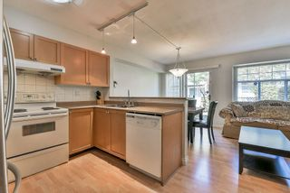 Photo 2: 102 9580 PRINCE CHARLES Boulevard in Surrey: Queen Mary Park Surrey Townhouse for sale : MLS®# R2295935
