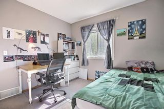 Photo 23: 403 950 Arbour Lake Road NW in Calgary: Arbour Lake Row/Townhouse for sale : MLS®# A1140525